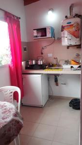 Una cocina o kitchenette en Cabañas & Aparts Yki Shamuaika