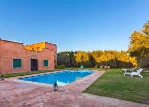 The swimming pool at or near Riad Harouak