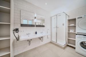 Ein Badezimmer in der Unterkunft Salzburg Residence by Welcome-to-Salzburg