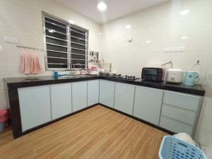 A kitchen or kitchenette at Boutique Homestay 2