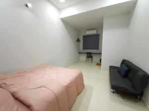 A television and/or entertainment center at Boutique Homestay 2