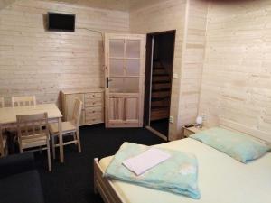 Postel nebo postele na pokoji v ubytování Pension U Horejšů