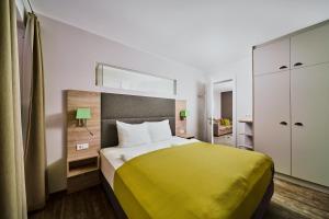 Ein Bett oder Betten in einem Zimmer der Unterkunft Villa Salzburg by Welcome-to-Salzburg