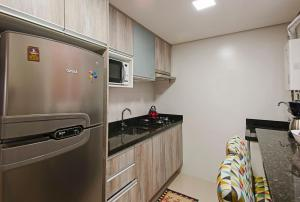 A kitchen or kitchenette at APARTAMENTO A 20m DA CATEDRAL