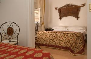 A bed or beds in a room at Hotel Fontana