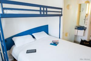 A bed or beds in a room at ibis budget Béziers Centre Palais Congres