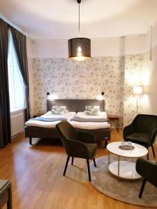 Säng eller sängar i ett rum på Hotel Duxiana Kristianstad