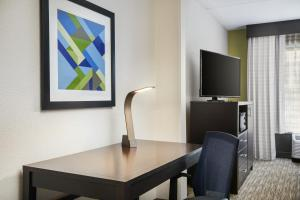 A television and/or entertainment center at Holiday Inn Express & Suites Jacksonville South East - Medical Center Area, an IHG Hotel