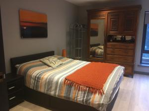 A bed or beds in a room at Apartment looking over Lough Gill