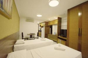 A bed or beds in a room at Ponta Negra Flats Partic