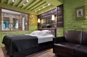 Un ou plusieurs lits dans un hébergement de l'établissement Hôtel du Château & Spa - Les Collectionneurs