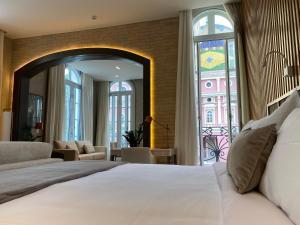 A bed or beds in a room at Juma Ópera