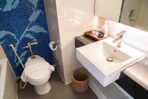Een badkamer bij Grand Jomtien Palace Hotel