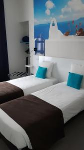 Un ou plusieurs lits dans un hébergement de l'établissement Art Hotel Tendance