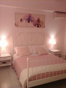 Letto o letti in una camera di B&B La Casa di Isabella Loreto