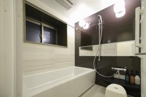 A bathroom at Takuto Stay Osaka Hommachi West
