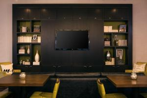 A television and/or entertainment center at Courtyard New York Manhattan/Midtown East
