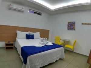 A bed or beds in a room at Maragogi Suítes