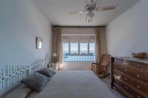 Ein Bett oder Betten in einem Zimmer der Unterkunft Expoholidays - Apartamento Crucero