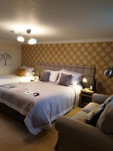 A bed or beds in a room at Scooniehill Farm House B&B