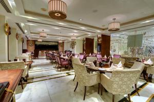 A restaurant or other place to eat at Tajview – IHCL SeleQtions