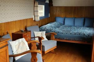 Een bed of bedden in een kamer bij B&B Dream On Wheels