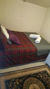 A bed or beds in a room at Flow stay apartment