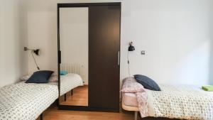 Cama o camas de una habitación en AT Compañía 9