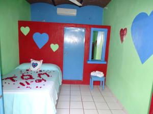 A bed or beds in a room at Hotel Corazon Sayulita