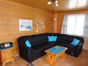 Ein Sitzbereich in der Unterkunft Apartment Regina