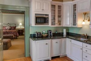 A kitchen or kitchenette at Beaumont Hotel and Spa - Adults Only
