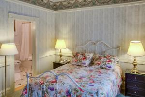 A bed or beds in a room at Beaumont Hotel and Spa - Adults Only