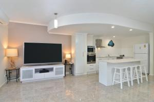 A television and/or entertainment center at Reef Terraces on St Crispins