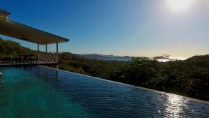 The swimming pool at or near Amazing ocean view in a luxurious villa