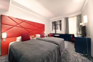 Tempat tidur dalam kamar di Shiba Park Hotel