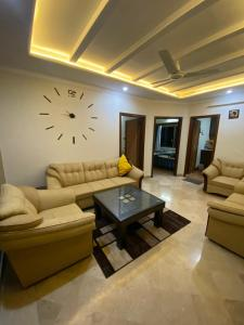 A seating area at Hill View/ 2BHK Cozy Apartment/ Central City
