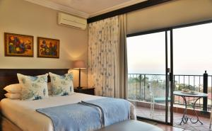 A bed or beds in a room at The Vineyard on Ballito