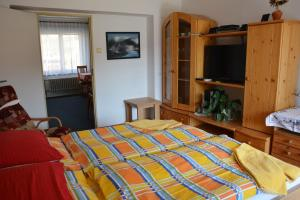 A bed or beds in a room at Penzion Jarmilka