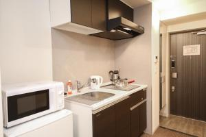 A kitchen or kitchenette at Takuto Stay Osaka Hommachi West