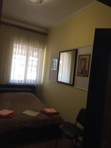 Кровать или кровати в номере Апартаменты в Ессентуках