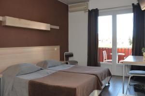 Un ou plusieurs lits dans un hébergement de l'établissement Hotel Le Terminus