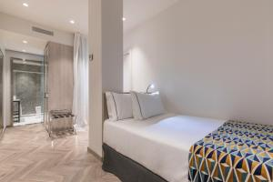 A bed or beds in a room at Eurostars Puerta Real