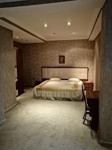 Cama ou camas em um quarto em Abu Arena Hotel