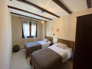 Cama o camas de una habitación en Alojamiento Rural El Refugio