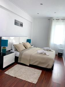 A bed or beds in a room at Lisboa-Marvila