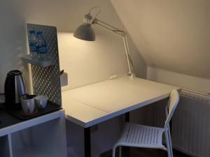 A kitchen or kitchenette at Kaiser Homestay
