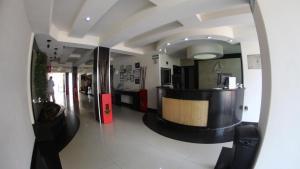 The lobby or reception area at Hotel Portonovo Plaza Malecon