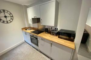 A kitchen or kitchenette at The Works Apartments Liverpool