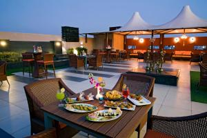 A restaurant or other place to eat at Regenta Central Cassia Zirakpur Chandigarh