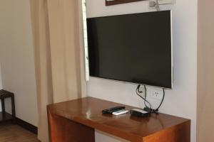 A television and/or entertainment center at Bantayan Hut